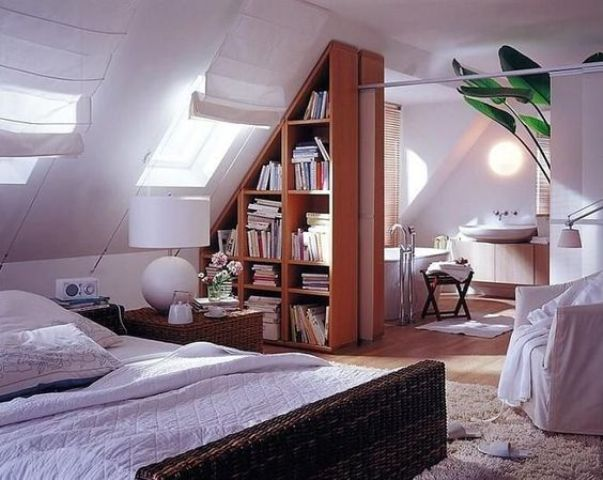 a triangle bookshelf unit is used to separate the attic bedroom and bathroom and make them feel airy