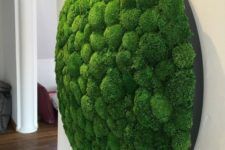 17 an oversized circle moss art piece is a bold and interesting decoration