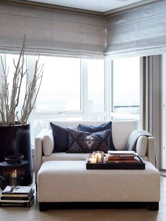 simple light grey roller shades are a great fit for any modern space