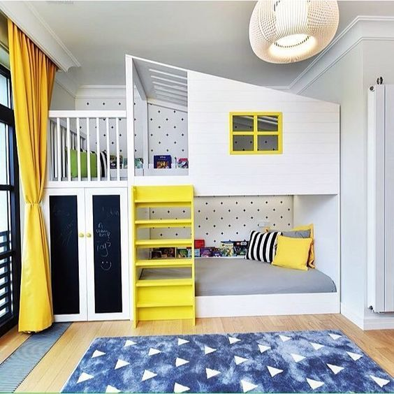 yellow touches and some blue ones make the room cheerful, and chalkboard doors and a polka dot wall add interest