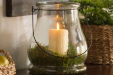a candle lantern with moss inside is a great idea for spring or summer