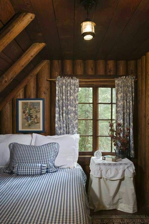 a country attic bedroom with a bed in the corner and a nightstand - nothing else is here to declutter the room