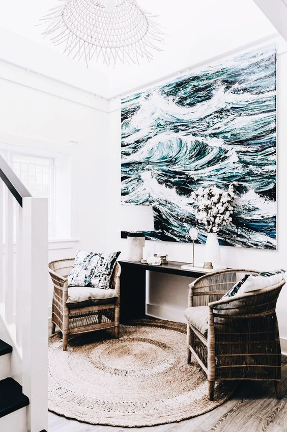 a large scale artwork takes over this small nook and makes it sea like and refreshing