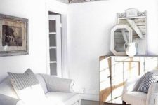 18 a whitewashed reclaimed wood ceiling with beams perfectly fits a shabby chic beach space