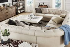18 an elegant space with a rustic feel and a gorgeous U-shaped tufted sofa of creamy color that makes it more refined