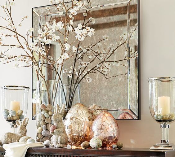 blooming branches, bunnies, mercury glass eggs and jars with candles and pastel-colored eggs