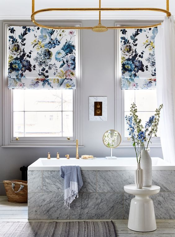 bold blue floral printed Roman shades add style to the bathroom and make it feel like summer