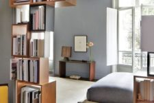 18 box-shaped shelves partly covering the entrance to the bedroom is a nice solution