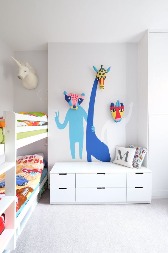 color is added with bold bedding and some bold animals painted on the wall