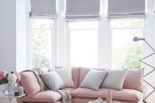 18 light grey Roman shades make the room more peaceful and tranquil