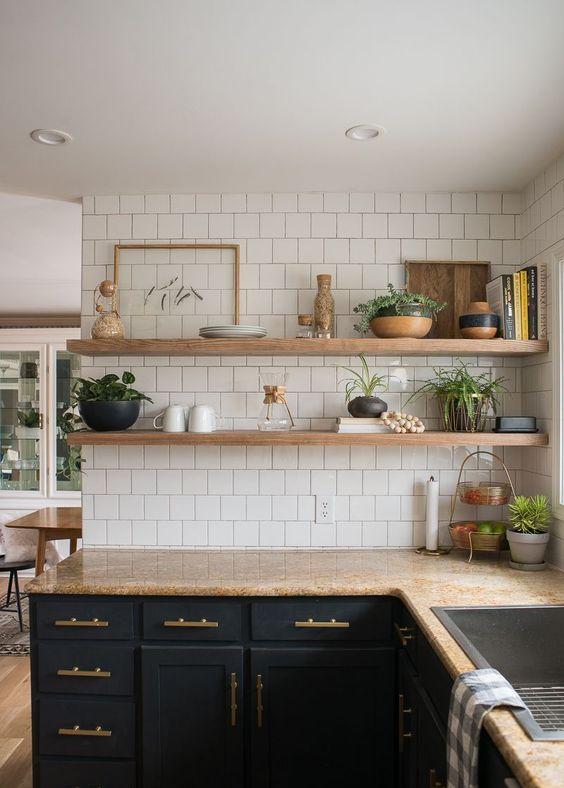 a modern farmhouse kitchen with open floating shelves that match the countertops