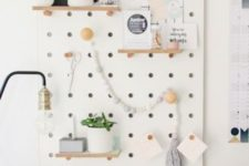 19 a white pegboard with shelves is a great piece that will accomodate a lot of things