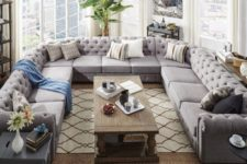 19 an oversized U-shaped grey tufted sofa makes a perfect fit for this unusually shaped living room