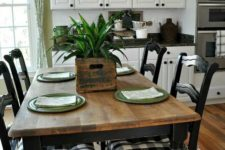 19 vintage black chairs with buffalo check upholstery plus a wooden table and woven lamps create a rustic look