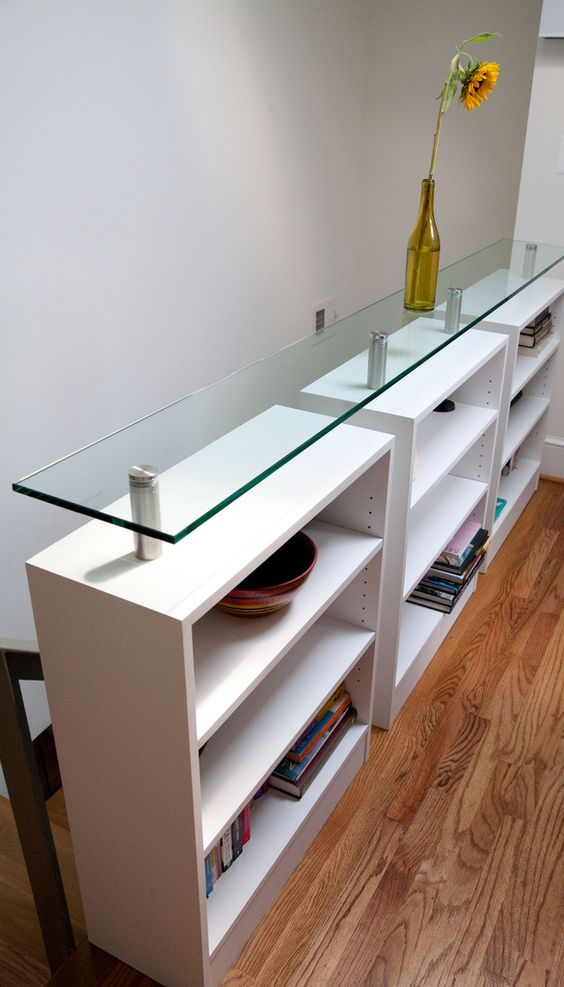 a pony storage wall with a glass top is a great idea to divide the staircase from the rest of the house
