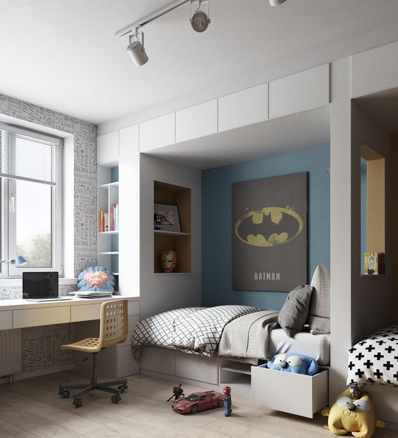 a super hero themed room with a Batman poster and an Iron Man mask plus Superman-inspired touches