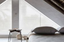 20 an attic bedroom with a bed placed in the corner, a zen feel and touches bring peacefulness to the space