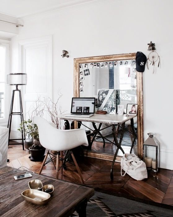 if you feel glam, go for an oversized vintage-framed mirror, your may also use it as a memo board