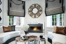 20 striped Roman shades with large tassels add a refined touch to the exquisite space