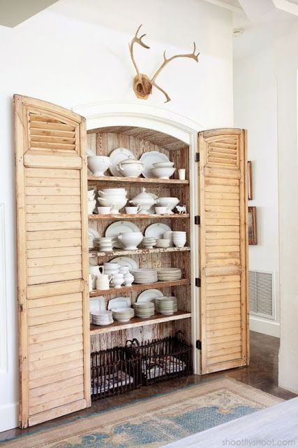a built in cupboard with shutters as doors is a sweet and cute idea for a farmhouse kitchen