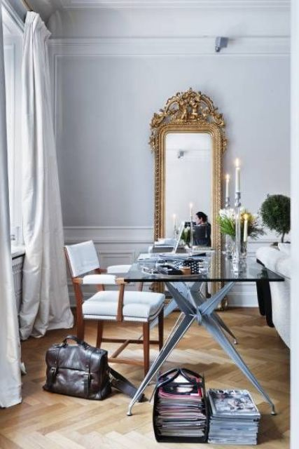 a chic glam home office with a tall narrow mirror in a vintage frame