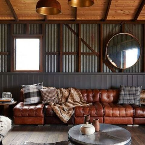 a long sectional sofa in various shades of brown is great for an industrial and rustic space
