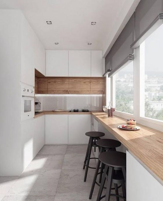 a sleek minimalist kitchen with a breakfast windowsill space