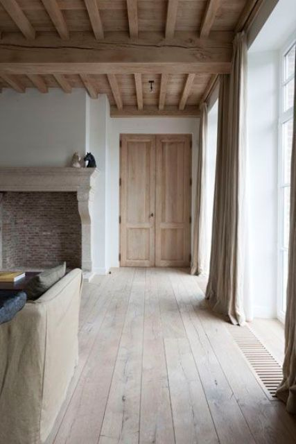 a warm rustic wood ceiling with beams adds eye catchiness and coziness to the space
