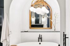 21 go for a stylish framed mirror in your bathtub niche for an elegant touch