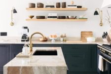 21 modern wooden shelves and eye-catchy stone surfaces make this kitchen very stylish