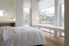 21 white semi sheer Roman shades will help to keep privacy in the bedroom and don't spoil the harmony of the room