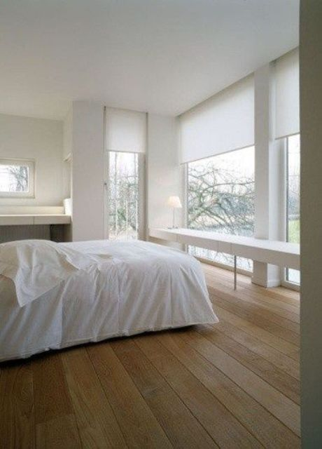 white semi sheer Roman shades will help to keep privacy in the bedroom and don't spoil the harmony of the room