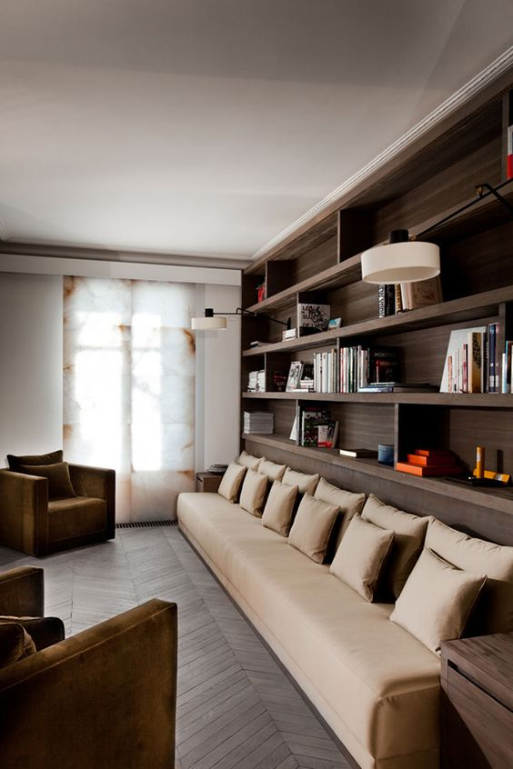 a beige long sectional sofa perfectly fits an extra long but narrow space and its color is very chic