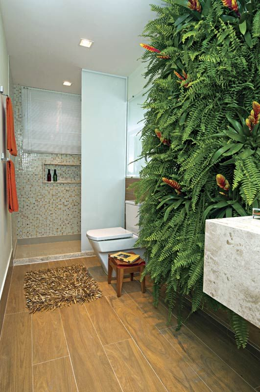 a gorgeous lush fern wall makes a natural statement and takes over the whole space