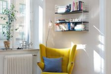 22 a modern take on a classic wingback in sunny yellow is a great base for a reading space