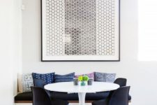 22 a small mid-century modern dining room with a bold graphic artwork that takes over it
