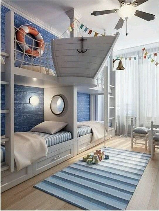 a unique ocean-inspired kids' room with a gorgeous boat bunk bed