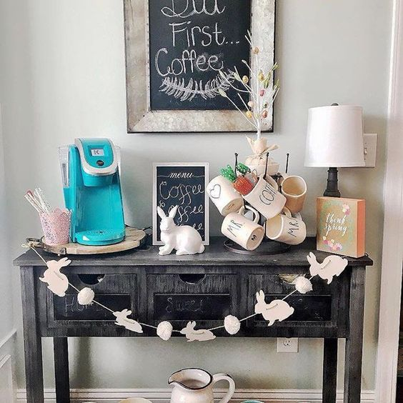 a vintage console with chalkboard drawers, a bunny and egg garland and porcelain bunnies