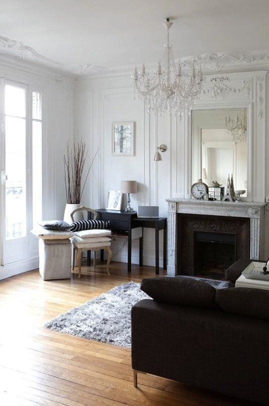 a vintage crystal chandelier and an antique fireplace for a gorgeous French-style living room