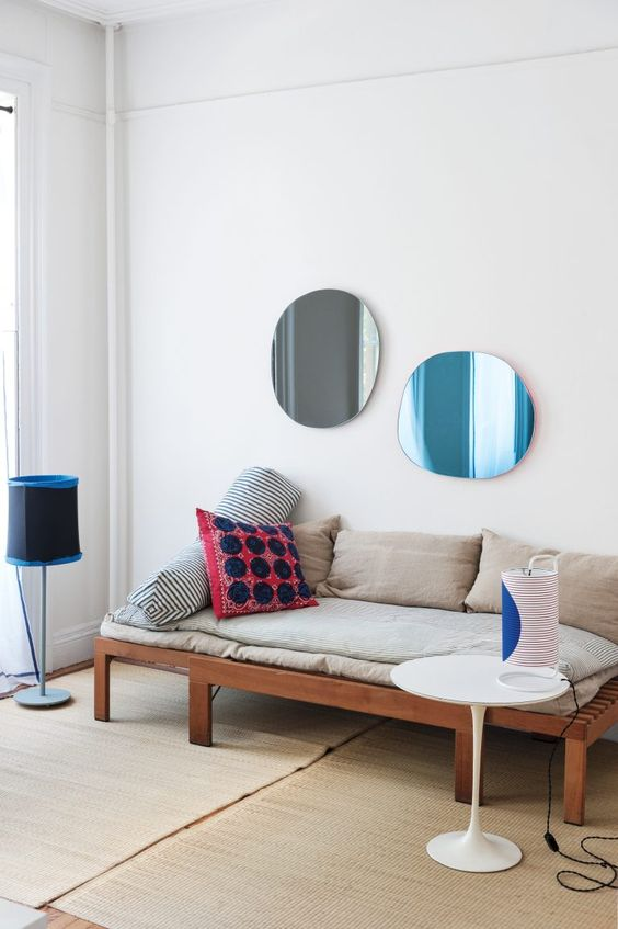 asymmetrical decorative mirrors in different colors - take two for more harmony in your space