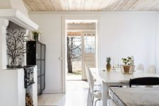 23 a light-colored wooden ceiling adds warmth to this white space and makes it cozier