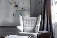 23 a modern take on a wingback with eye-catchy armrests and a matching foot stool