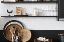 23 black open shelves match the cabinets and countertops but look less bulky
