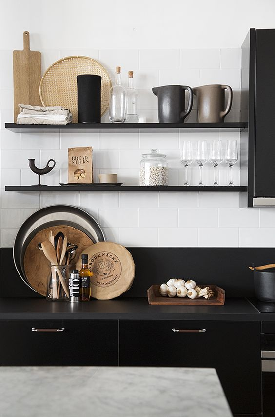 black open shelves match the cabinets and countertops but look less bulky