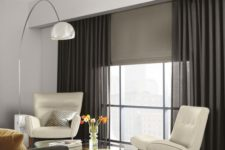 23 ripple fold draperies and a Roman shade for an additional touch, hiding from the sun when necessary