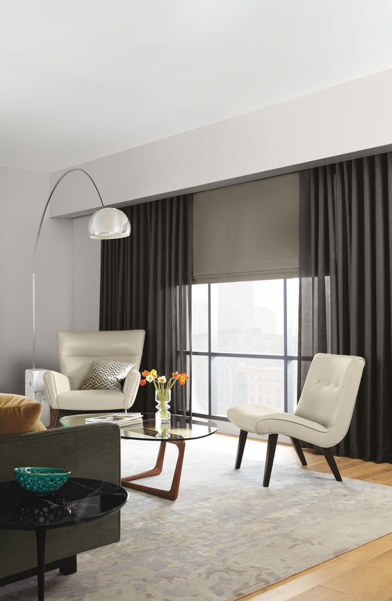 ripple fold draperies and a Roman shade for an additional touch, hiding from the sun when necessary