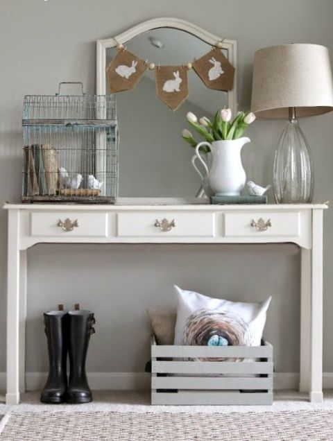 some tulips in the jug, a burlap bunny banner and a birdcage with birds and books are all you need