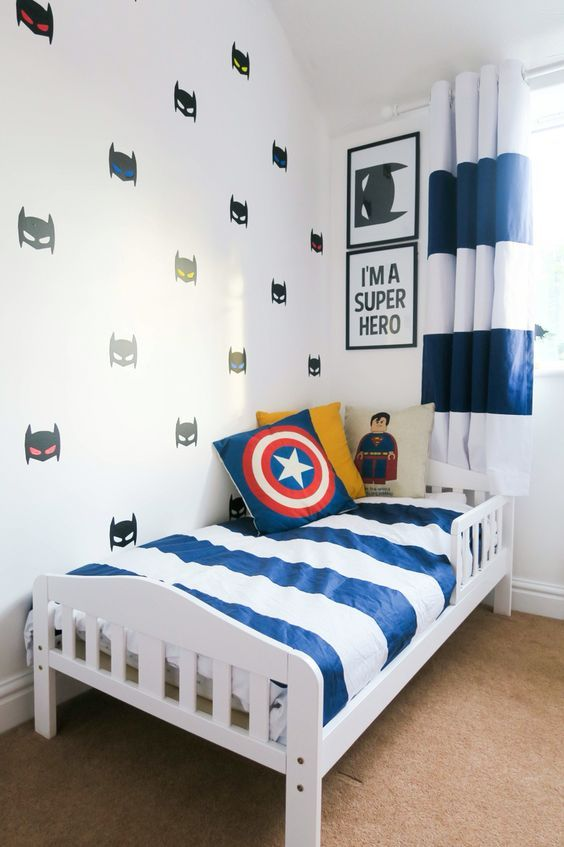super hero wall decals, pillows and some posters add a cool touch to this room