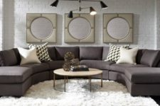 24 a laconic brown rounded sectional sofa is the base of this room, and everything is built around it