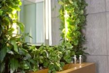 24 a living wall with a sink next to it will make you feel washing outdoors